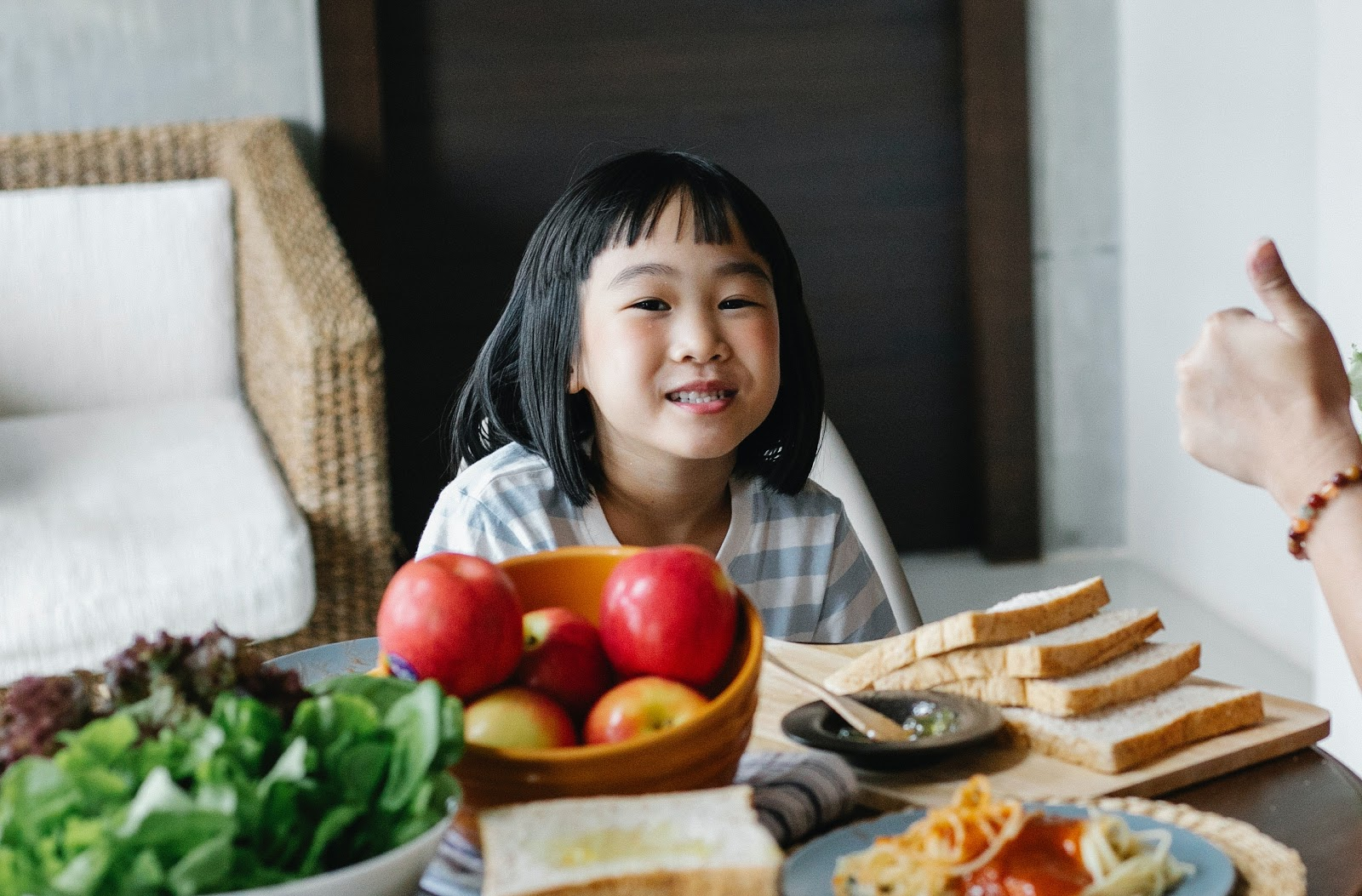 child at a snack table