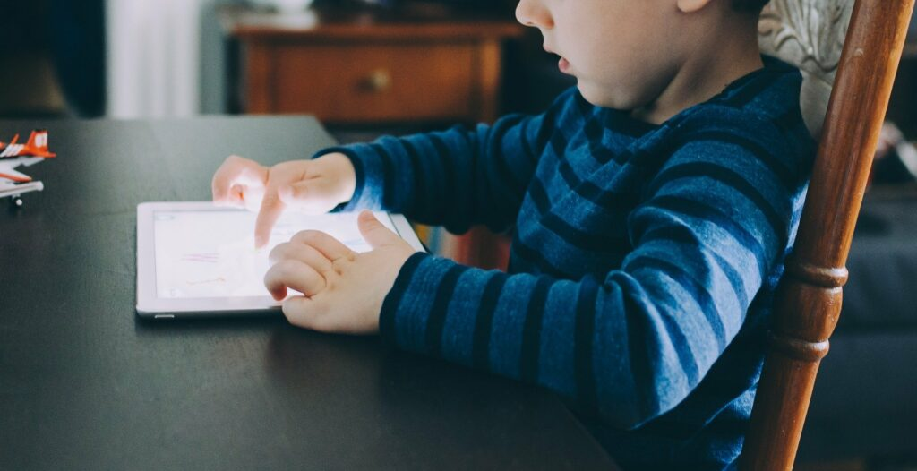 A child using a tablet device.
