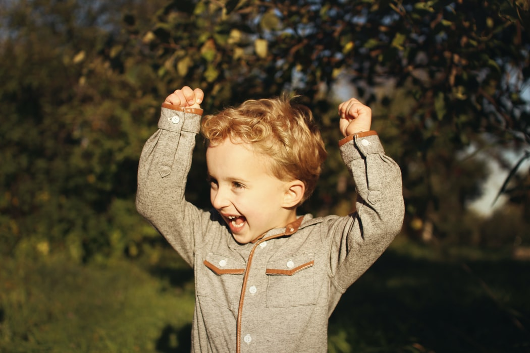excited-boy-raising-arms