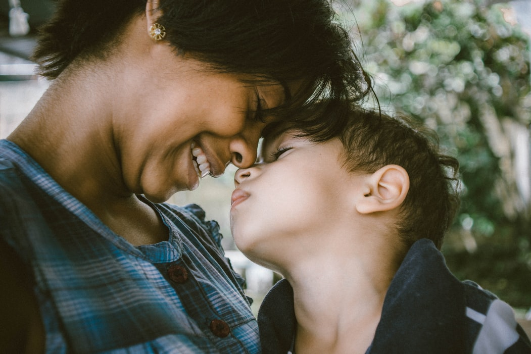 A mother smiling with her son