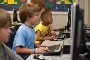 children learning with technology on computers