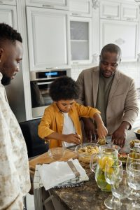 Child learns from parent to serve food