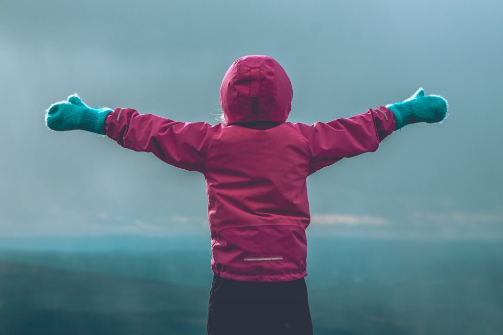 Child in coat looking at the horizon