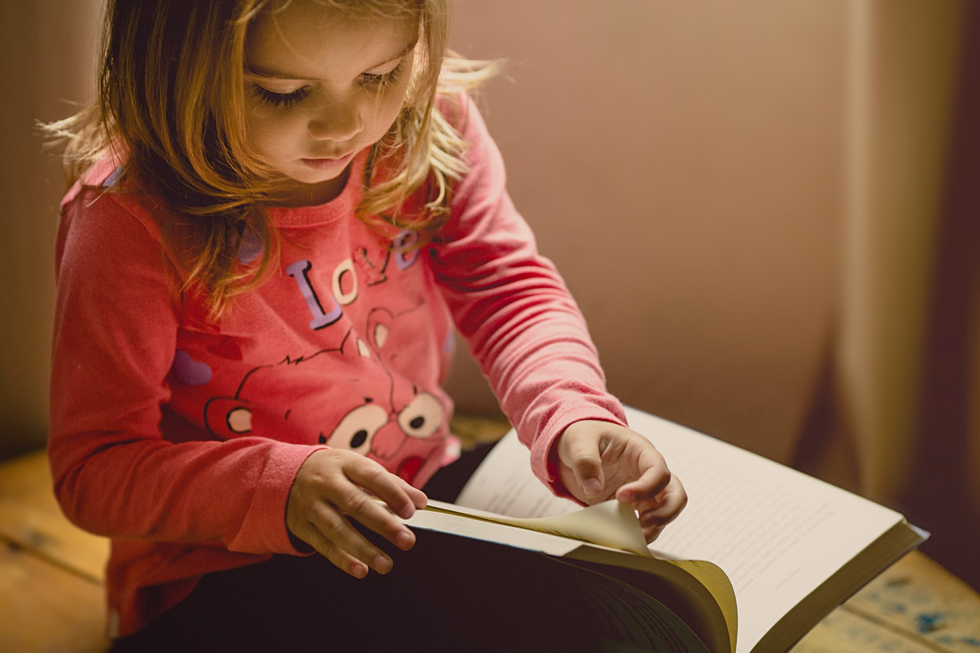 A young girl reading in a child-centered curriculum