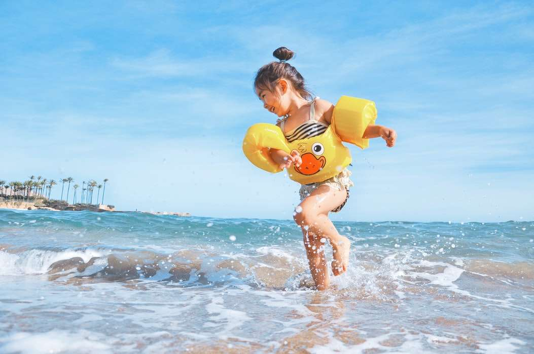 A young girl playing at the beach