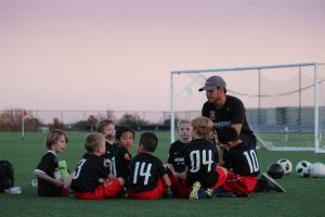 A father coaching his son's soccer team